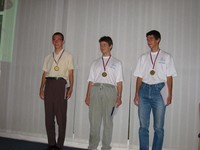 the three gold medalists: Peter Bella from Slovakia and two romanians